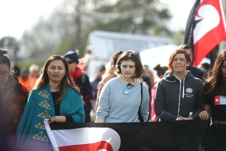 women with flags and banners protesting