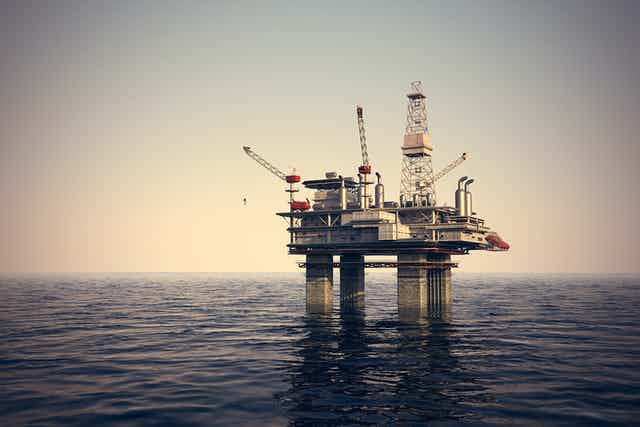 Faded image of oil rig in ocean