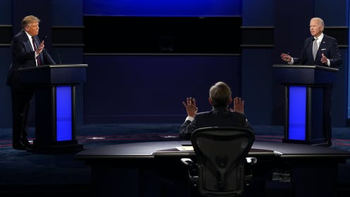 Moderator Chris Wallace, President Trump and  Joe Biden speak over each other during the first presidential debate