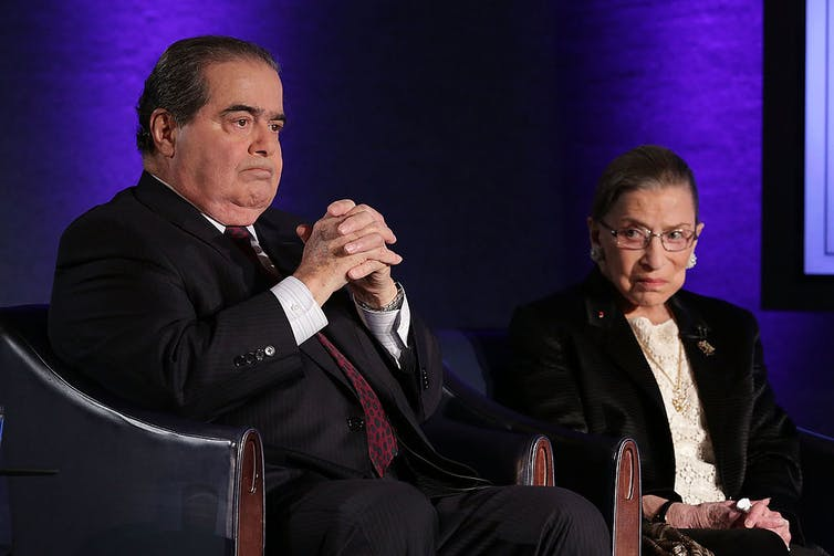 Scalia sits next to Ginsburg at the National Press Club in 2014.