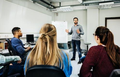 A speaker in a college classroom.