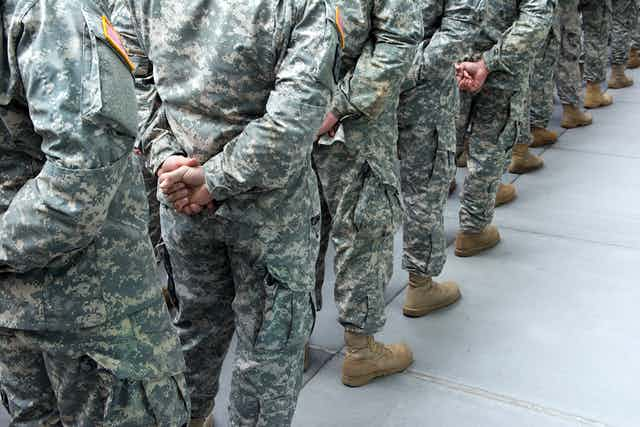 Soldiers standing in a line.