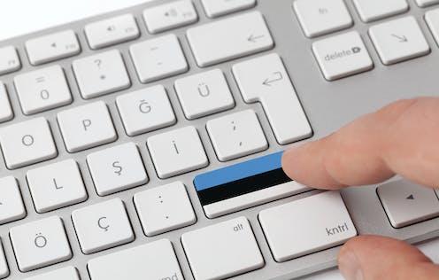 Pressing a key on a keyboard with Estonian flag.