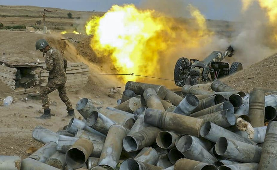 Soldier next to gun and fire ball.