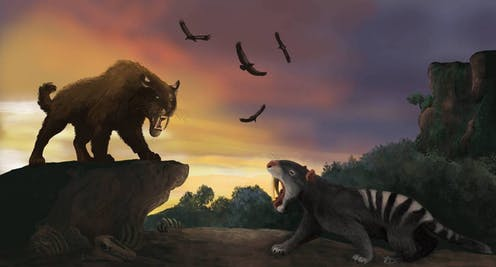Two fierce-looking prehistoric mammals growl at each other.