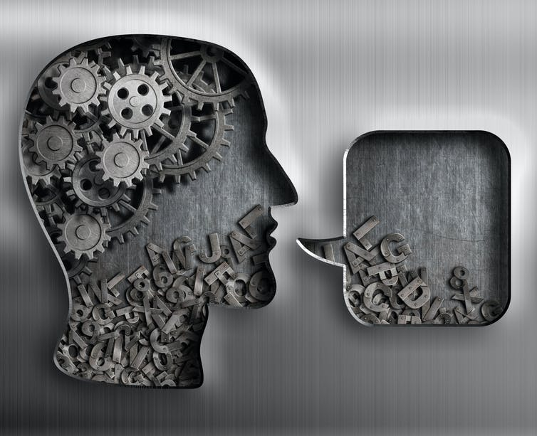 Outline of a head containing gears and letters, with speech bubble
