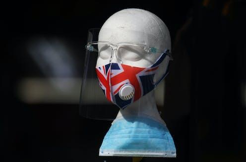 A union jack mask displayed on a styrofoam model of a head.