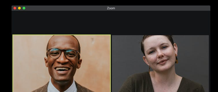 A man and woman on a Zoom call.