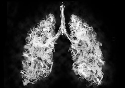 A photo illustration of smoke forming the shape of lungs.