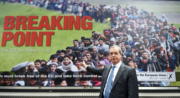 Nigel Farage stood in front of 'breaking point' anti-immigration poster.