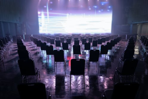 Empty concert venue, with chairs spaced out.