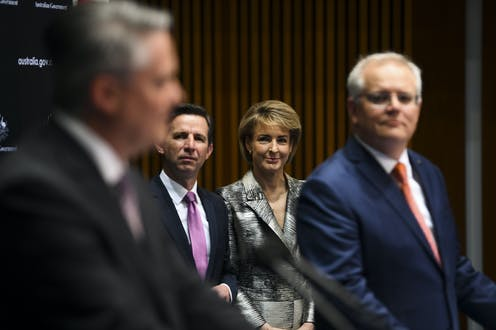 Mathias Cormann and Scott Morrison in the foreground, and Michaelia Cash and Simon Birmingham look on in the background