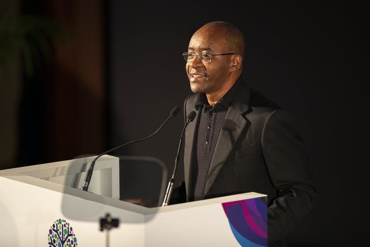 Zimbabwean tech billionaire Strive Masiyiwa speaking at a conference.