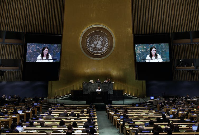 Delegates seated within United Nations general assembly