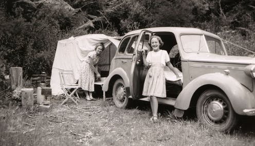Mother and daughter at family campsite in 1950s