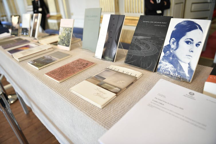 Table in a bookshop displaying books of poetry by American poet Louise Glück