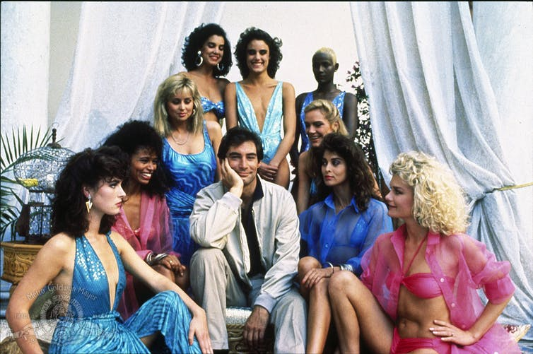 A very 80s collection of women surround Bond