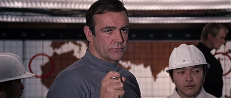 Sean Connery holds a cigarette in You Only Live Twice
