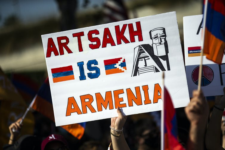 Protester holding up sign which says 'Artsakh is Armenia'.