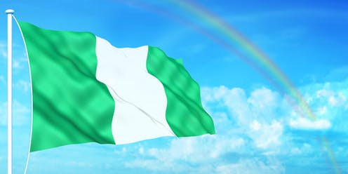 An illustration of a Nigerian flag flying, with clouds and a rainbow in the background