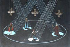 Set design feature four of Hamlet's characters in a round lit by spotlights with crosses hanging above.