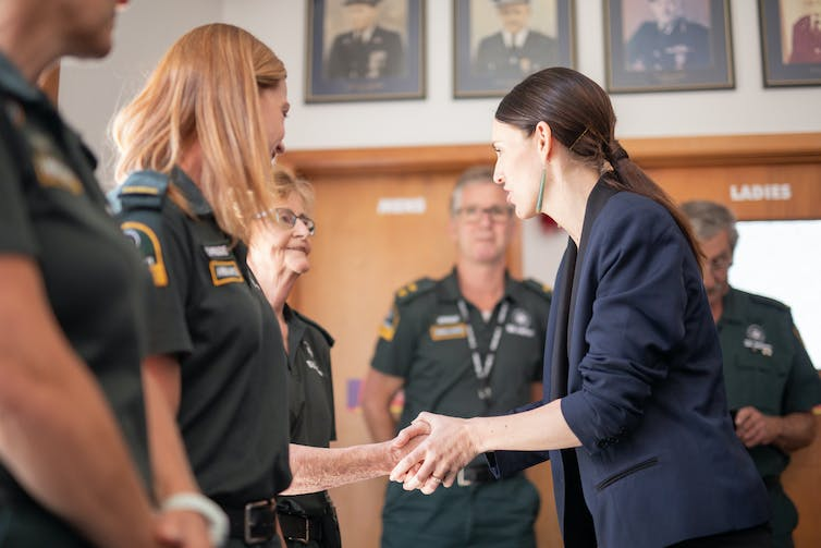 ambulance officers with Jacinda Ardern