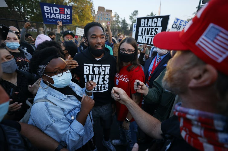Biden and Trump supporters clash prior to the vice-presidential debate in Salt Lake City on October 7 2020. Photo: Jeff Swinger/AP