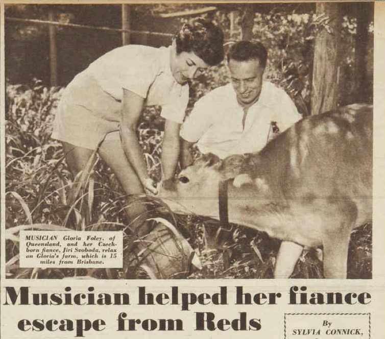 A man and a woman feed a calf. Magazine headline reads: musician helped her fiancé escape from Reds.