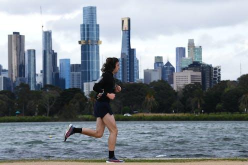 Person running around Albert Park Lake