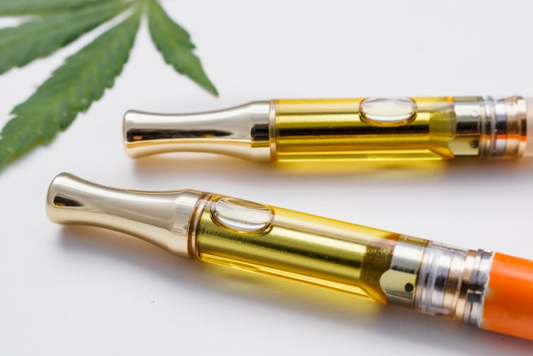 Two vape pens containing cannabis oil.