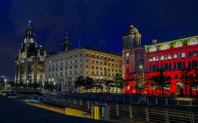 The Liverpool docks lit up at night.