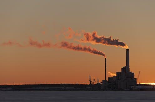 Power plants releasing smoke.