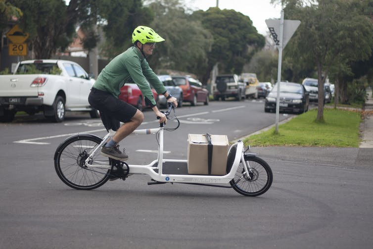 The author riding a cargo bike.