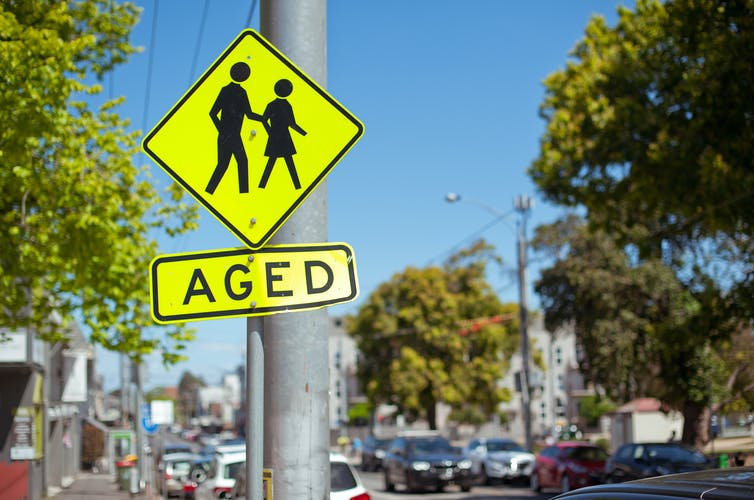 A street sign saying 'AGED'.