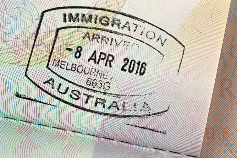 Passport stamp, showing 'immigration, arrived in Melbourne 2016'.