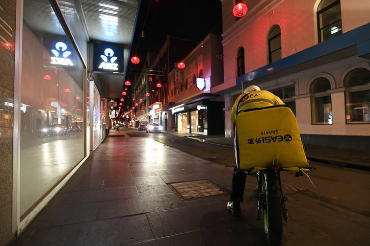 A delivery rider in Melbourne's CBD, August 8 2020.