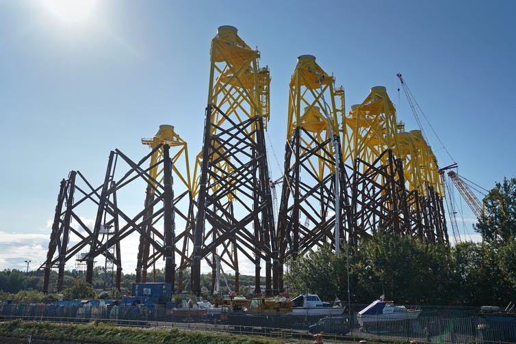 Black and yellow industrial structures.