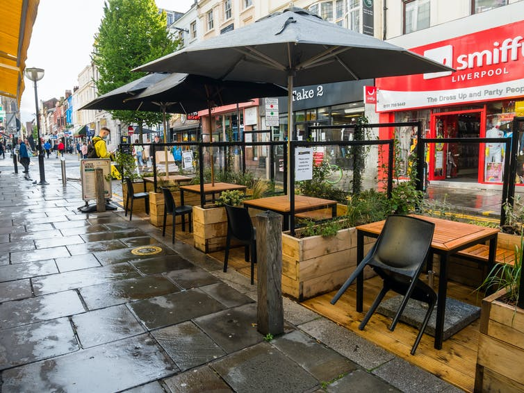 Street with empty outdoor restaurant seating area