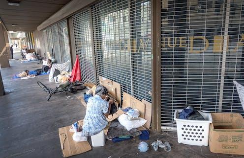 People sleeping rough outside shops