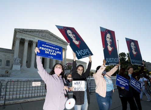 A group of anti-abortion activist women demonstrating in front of the Supreme Court.
