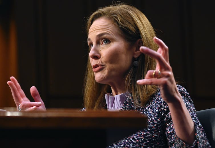 Judge Amy Coney Barrett gesturing with her hands at her confirmation hearing.
