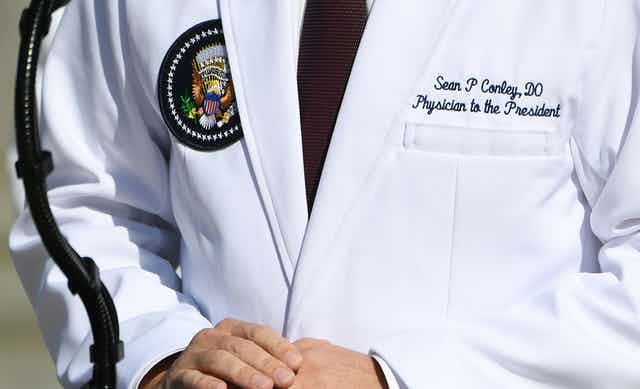 Dr. Conley's white coat with DO credential