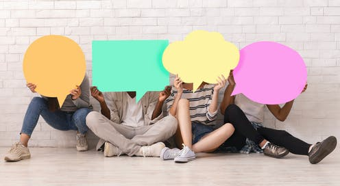 Teens hold speech bubbles in front of their faces.