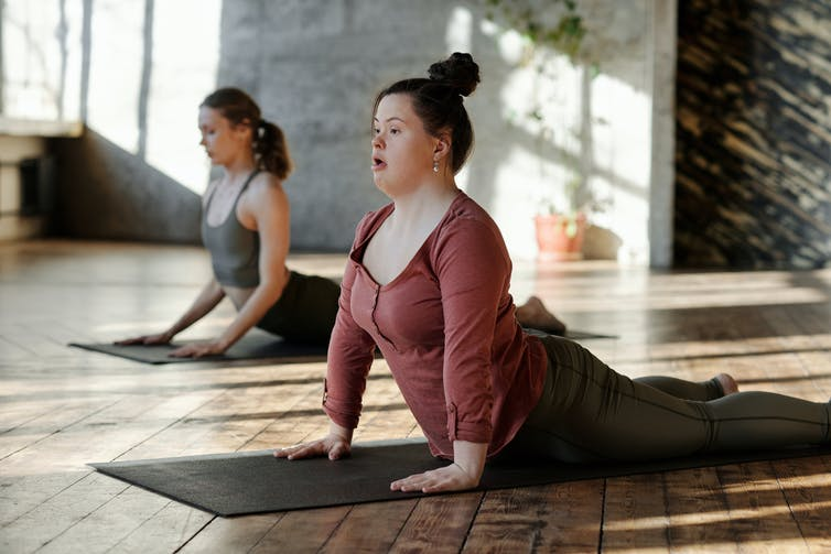 A young woman with Down syndrome at yoga class.
