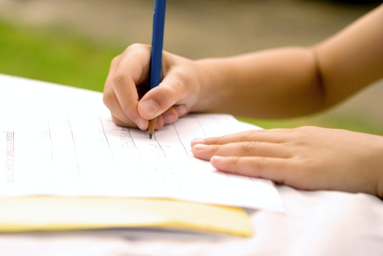 Young child learning to write.