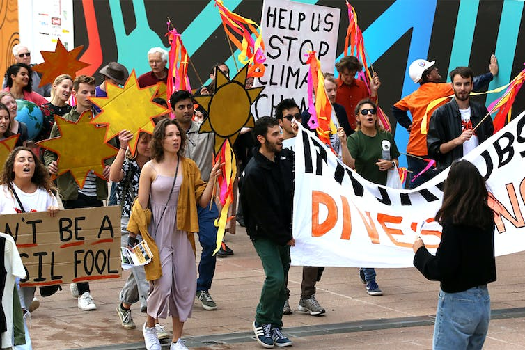 University students march to demand action on climate change