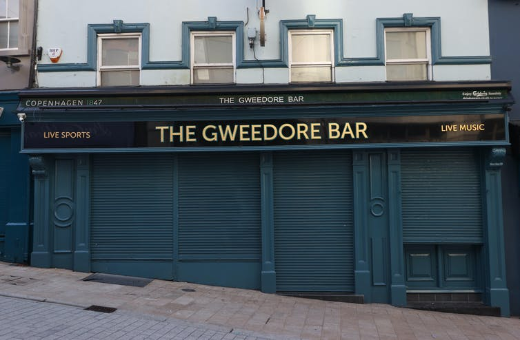 A closed bar in Northern Ireland, with its shutters down.