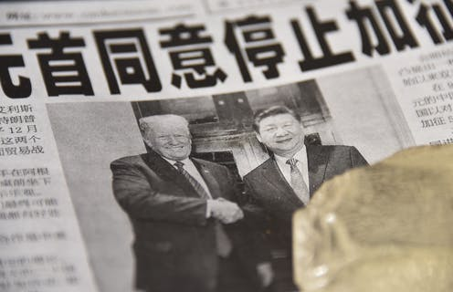 A Chinese newspaper features a front page photograph ofU.S. President Donald Trump shaking hands with Chinese President Xi Jinping.