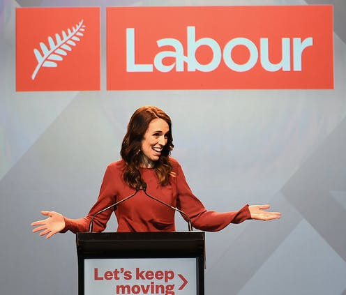 Jacinda Ardern at the podium accepting victory on the election.