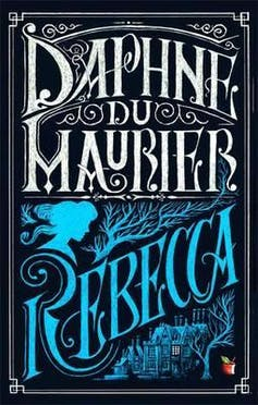 Book cover: blue and white lettering reads Daphne du Maurier, Rebecca